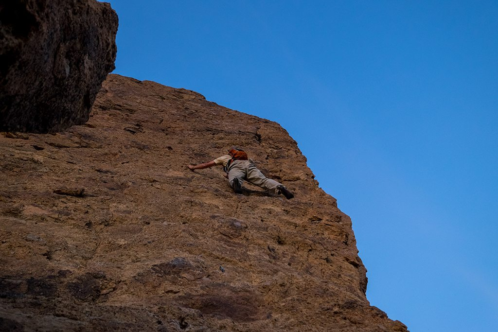 Free solo climber on the top of the cowdog